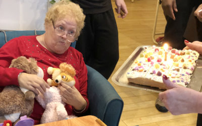 Bromley Park Care Home lady resident receiving her sweetie birthday cake