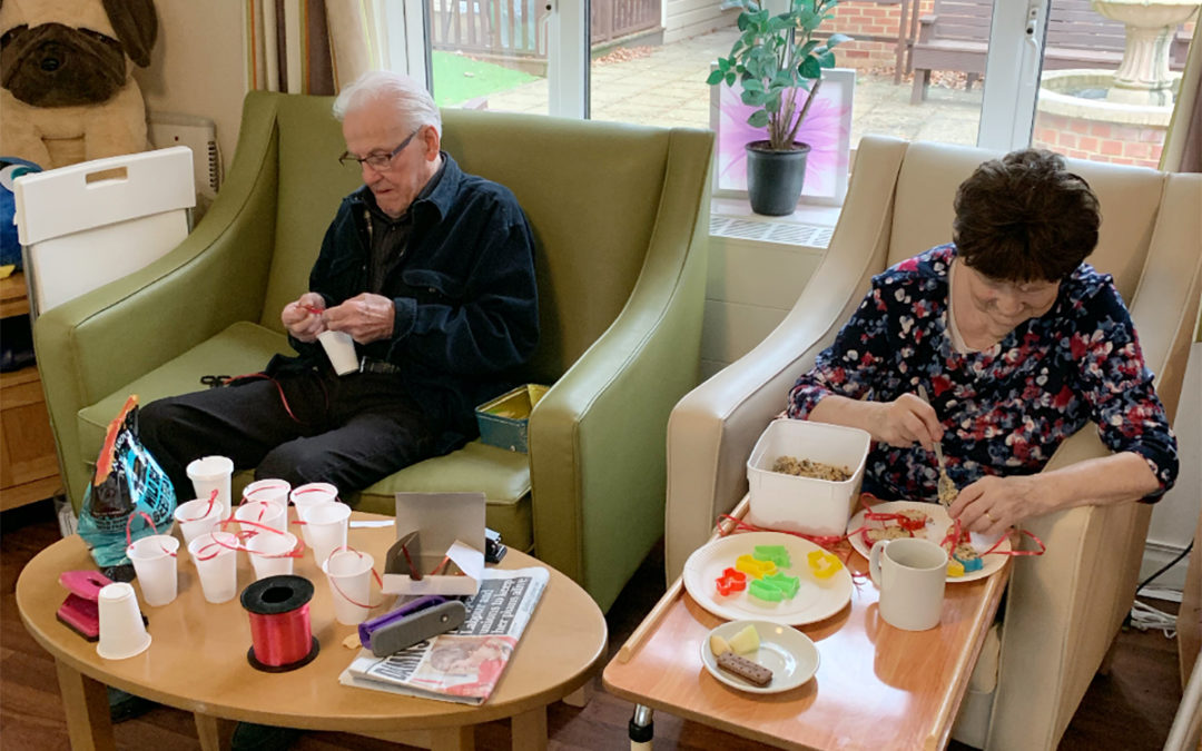 Busy making bird feeders at Lulworth House Residential Care Home