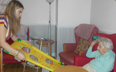 Princes Trust volunteer with a lady resident playing a target games with a beanbag