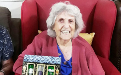 Lady resident with a G&T set won on a raffle at Lulworth House