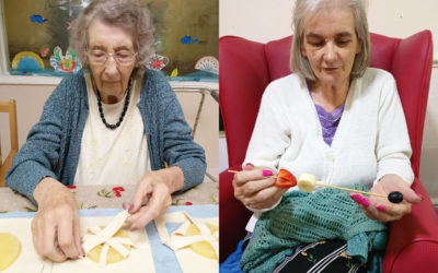 Lady residents making pineapple tarts and fruit kebabs at Lulworth House