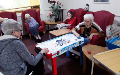 Residents playing air hockey at Lulworth House