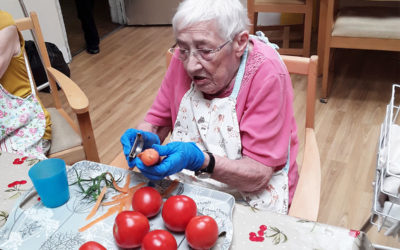 Lady resident prepping tomatoes to make soup